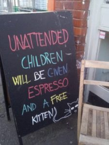 Restaurant sign warning patrons not to leave children unattended.