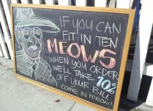 Restaurant sign offering ten percent off if patrons meow.